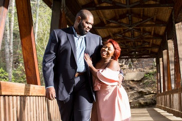 Happy Couple Walking Under a Shade - Wedding Planner in Atlanta - Kris Lavender