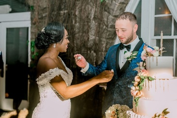 Bride and Groom Feeding Each Other Cake - Wedding Planner Marietta GA at Kris Lavender