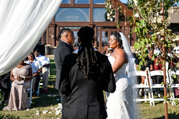 Candis and Mecha Taking Wedding Vows - Wedding Planning Packages by Kris Lavender - Event Planning Company Atlanta