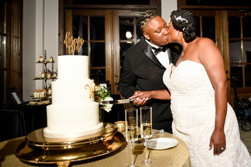 Candis and Mecha cutting the Wedding Cake - Wedding Planning Services by  Kris Lavender