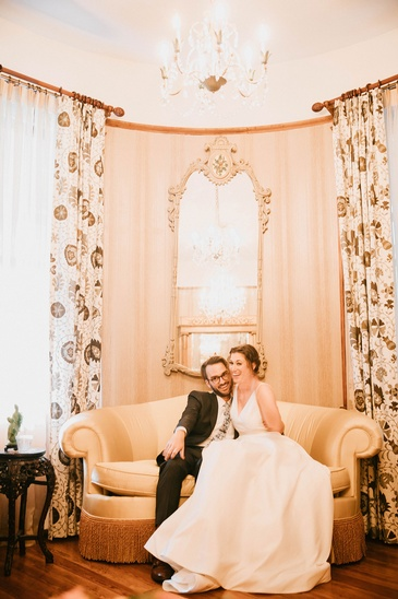 Newly Wed Couple Sitting on a Couch - Wedding Packages Atlanta by Kris Lavender